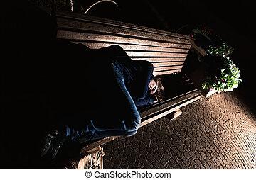 Homeless girl on the bench - Homeless girl sleeping on a...