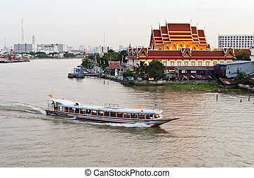 Wat thai and Chaopraya Boat - A photo of Wat Wimut and...