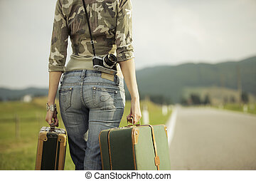 Travel on the road - Young woman runaway walks away road....