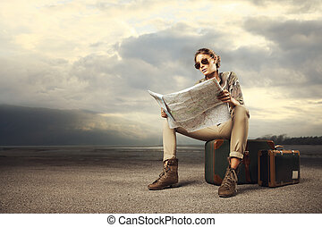 Travel destination - Beautiful young woman sitting on a...