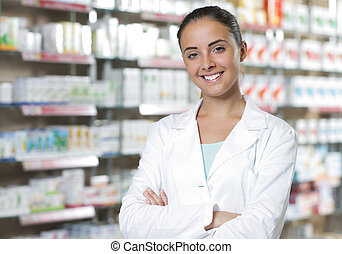 Portrait of Smiling Woman Pharmacist in Pharmacy -...