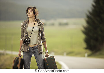 Travel on the road - Young woman runaway walks away road...