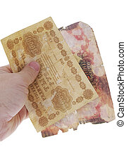 Unique old russian banknote (1918 year)in hand isolated on...
