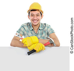 happy worker and blank board - Construction worker leaning...