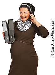 Happy business pregnant woman talking by phone mobile and...