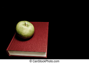 Back to School Concept - An apple on a book.