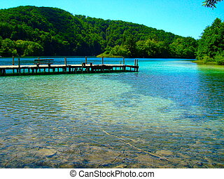 Plitvice Lakes - A wooden pier in the Plitvice Lakes,...