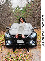 Beautiful woman and car - Beautiful dark-haired woman and...