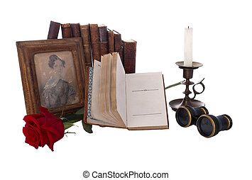 Still life with antique books and old photos. Isolated on white. Reproduction of the beginning of XIX century