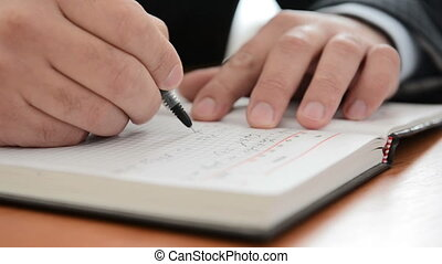 Businessman taking notes. Close view. Full HD
