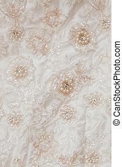Wedding background with cream silky decoration accessories, lace and pearls