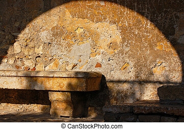 Quiet Corner - Old stone bench - concept of peace and inner...