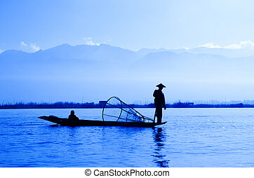 Inle Lake, Myanmar - Silhouette fisherman at Inle Lake,...