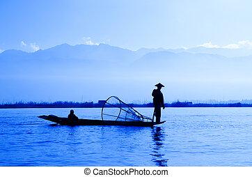 Inle Lake, Myanmar - Silhouette fisherman at Inle Lake,...