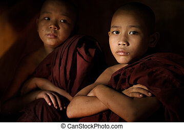 Novice monk - Young buddhist novice monk inside a temple...