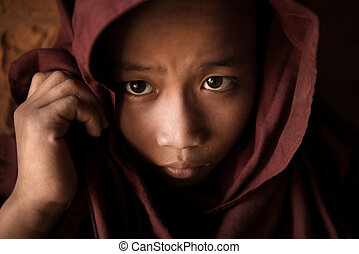 Novice - A young novice monk covered his head by robe
