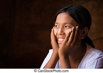 Myanmar girl hand holding on her face