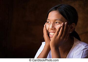 Myanmar girl hand holding on her face