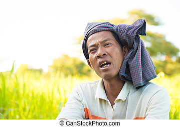 Myanmar man talking with his friend in farmland
