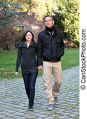 Young couple approaching walking hand in hand
