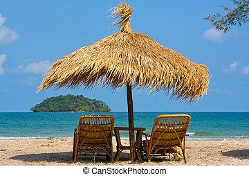 Sun loungers with an umbrella on the beach