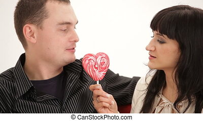Couple eating a candy