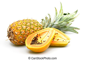 Tropical Fruit - Papaya and pineapple photographed on a...
