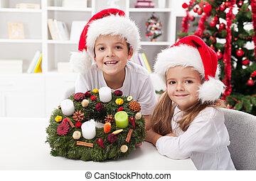 Kids holding advent wreath