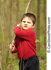 Defence - Martial art training: boy in red with stick...