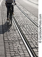 Woman Cycling Close to Tram Track, Switzerland, Europe