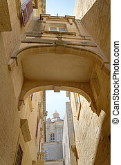 House Bridge in Mdina HDR - An arched bridge connecting two...