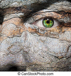 Conceptual image of a face with a bark skin - Conceptual...