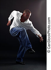 Hip hop man dancer against black background