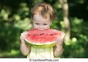 baby girl eating watermelon - cute little baby girl eating...