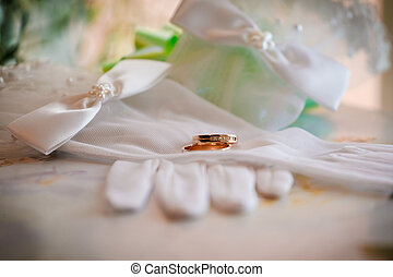 gold wedding rings on gloves