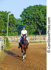 woman riding her horse in the parcour