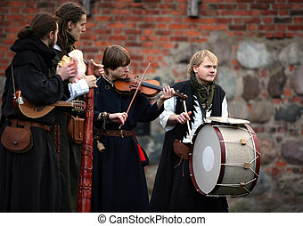 Medieval musicians during procession. Show in Kaunas