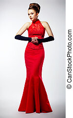 Luxurious beautiful bride dressed in red fashion modern dress