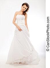 Beautiful bride in luxurious white wedding long dress posing