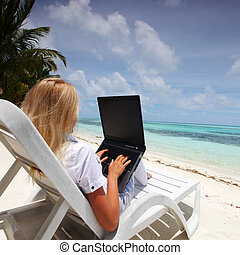 tropical business woman with laptop - business woman with...