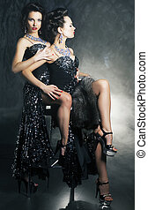 Homosexual couple of young flirting women in erotic pose...