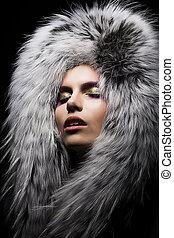 Beautiful young sensual woman in fur fashion collar