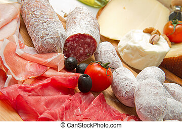 cold cuts and cheese - composition of cold cuts on wooden...