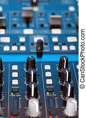 Control knobs on the console of a DJ deck for mixing,...