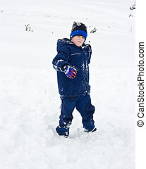 Boy throwing snowball - Little boy throwing snowball