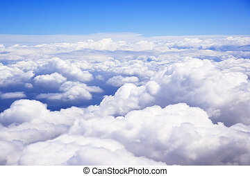Clouds as viewed out the window of an airplane