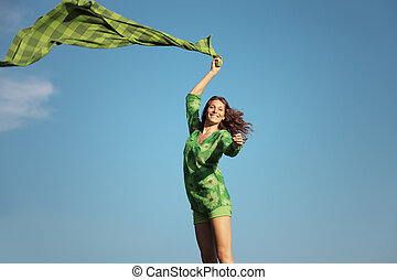 Freedom woman - Happy beautiful woman with a green tissue...