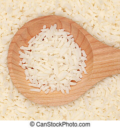 Cooked rice - Boiled rice on a wooden spoon forming a...