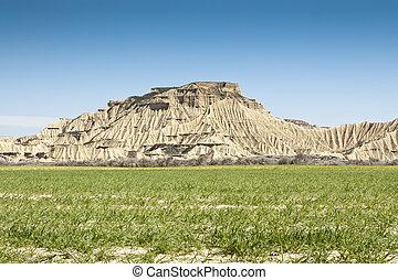 Semi-desert landscape in Bardenas Reales, Navarre, Spain The...