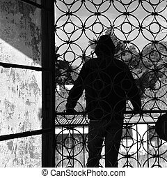 man on balcony of abandoned house - Man on the balcony of an...